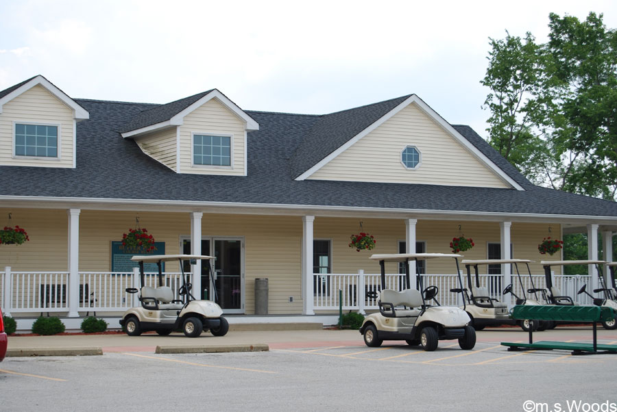 Golf Carts sit outside the Brookshire Pro Shop