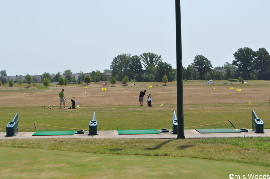 Golfers Taking Full Advantage of the Driving Range