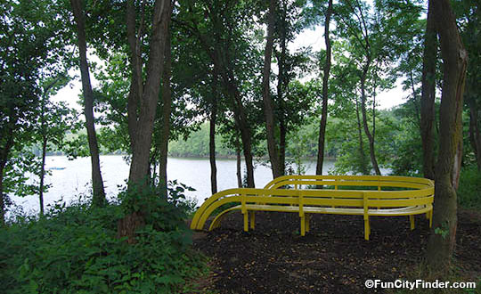 A modern bench at the 100 Acres Art and Nature Park